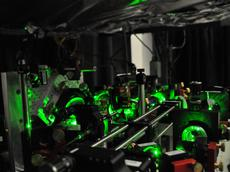 Part of the optical system used to trap and manipulate atoms. The arrangement of mirrors and lenses brings the a large number of laser beams onto the atoms. (Photo : Jean-Philippe Brantut / ETH Zurich)